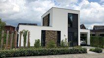Gerealiseerde Nieuwbouw - Modern nieuwbouw huis met stucwerk en natuursteen te Oosterhout