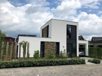 Modern nieuwbouw huis met stucwerk en natuursteen te Oosterhout - Modern nieuwbouw huis met stucwerk TEKST