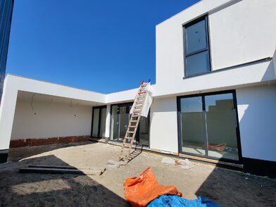 Modern nieuwbouw huis met stucwerk en natuursteen te Oosterhout - Modern nieuwbouw huis met stucwerk FOTO